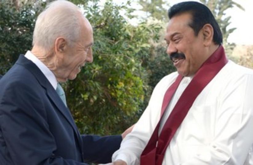 President Shimon Peres greets Sri Lankan President Mahinda Rajapaska in Jerusalem (photo credit: Mark Neiman/GPO)