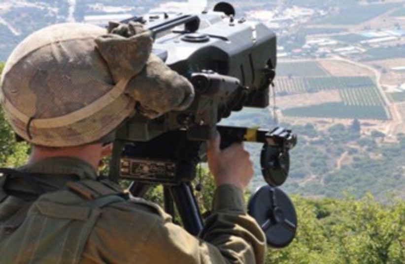 A combat intelligence soldier surveying the field. (photo credit: IDF Spokesman's Office)