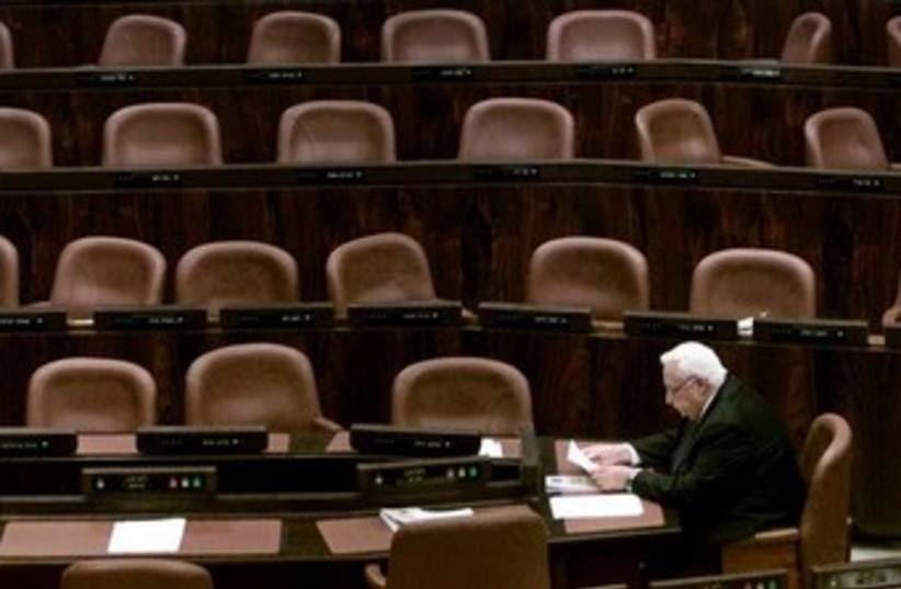 Ariel Sharon alone at the Knesset [file]. (photo credit: REUTERS/Natalie Behring)