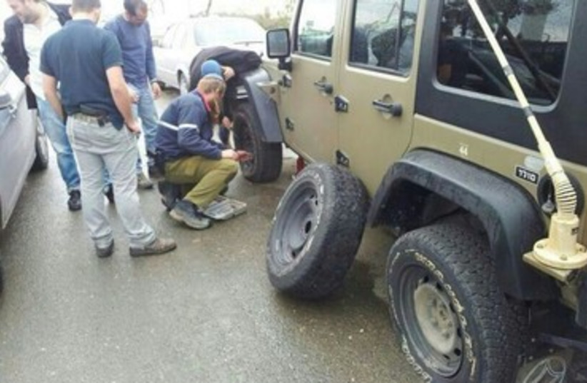 Army vehicle with punctured tires, West Bank, January 10, 2014 (photo credit: IDF Spokesperson, Courtesy)