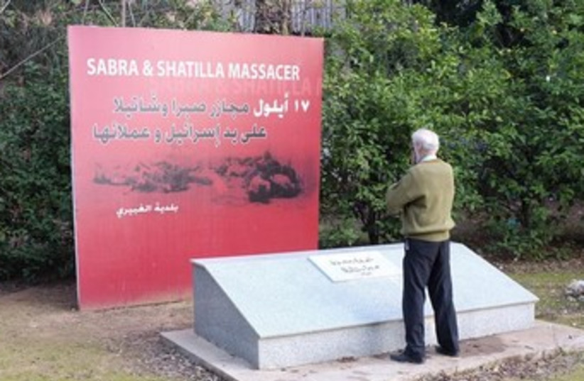 Massacre survivor Yousef Hamzeh prays at the site of the Sabra and Shatila massacre on the outskirts of Beirut January 11, 2014. (photo credit: Reuters)