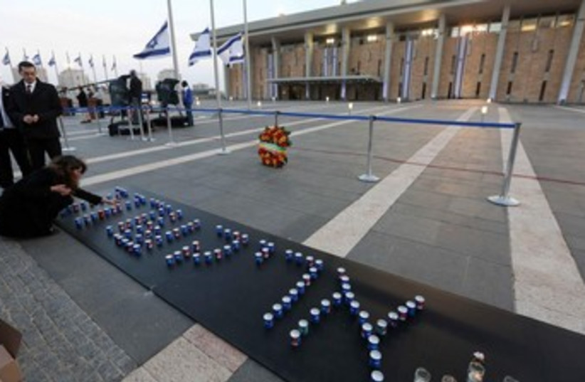 Candles spelling Ariel Sharon's name outside the Knesset, January 12, 2014. (photo credit: Marc Israel Sellem/The Jerusalem Post)