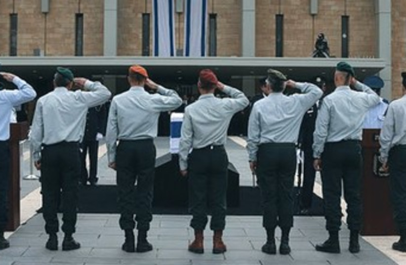 IDF generals salute the coffin of former prime minister Ariel Sharon at the Knesset  (photo credit: Marc Israel Sellem/The Jerusalem Post))