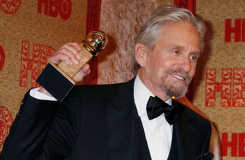 Michael Douglas poses with his Golden Globe. (photo credit: reuters)