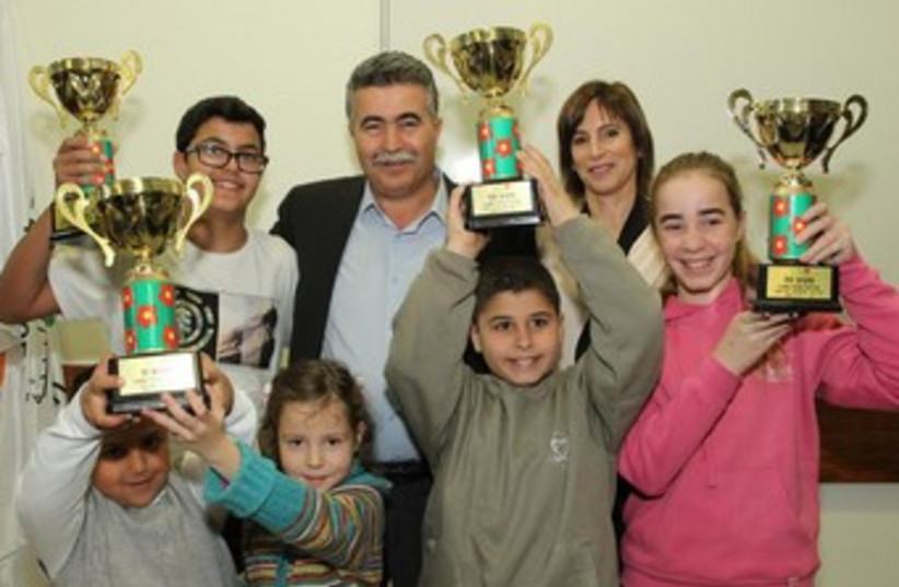 A recycling award was presented to students from various schools that excelled in recycling.  (photo credit: Yoni Reif)