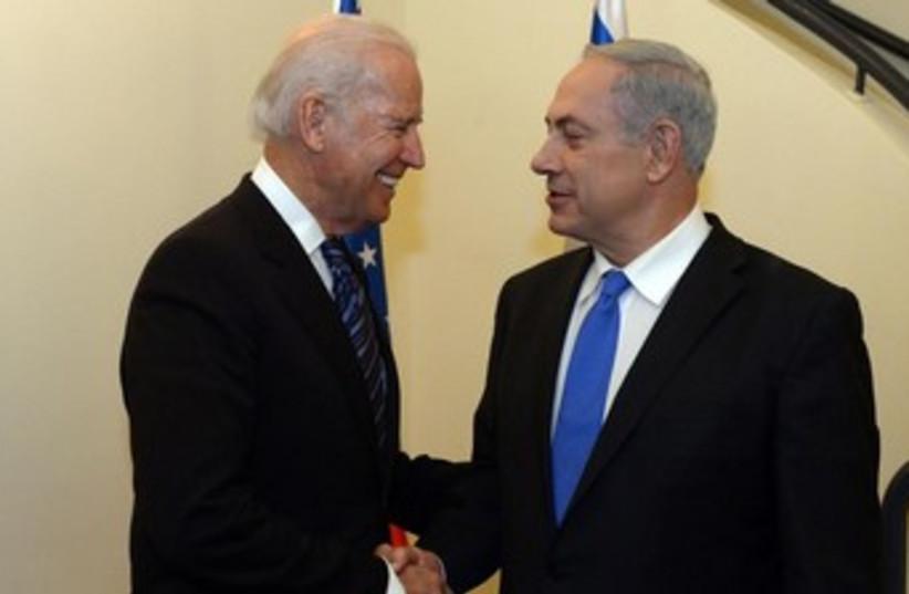 US Vice President Joseph Biden and Prime Minister Binyamin Netanyahu. (photo credit: GPO/Haim Zach)