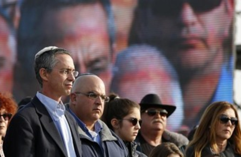 The sons of former prime minister Ariel Sharon, Gilad (L) and Omri (2nd L). (photo credit: REUTERS/Baz Ratner )
