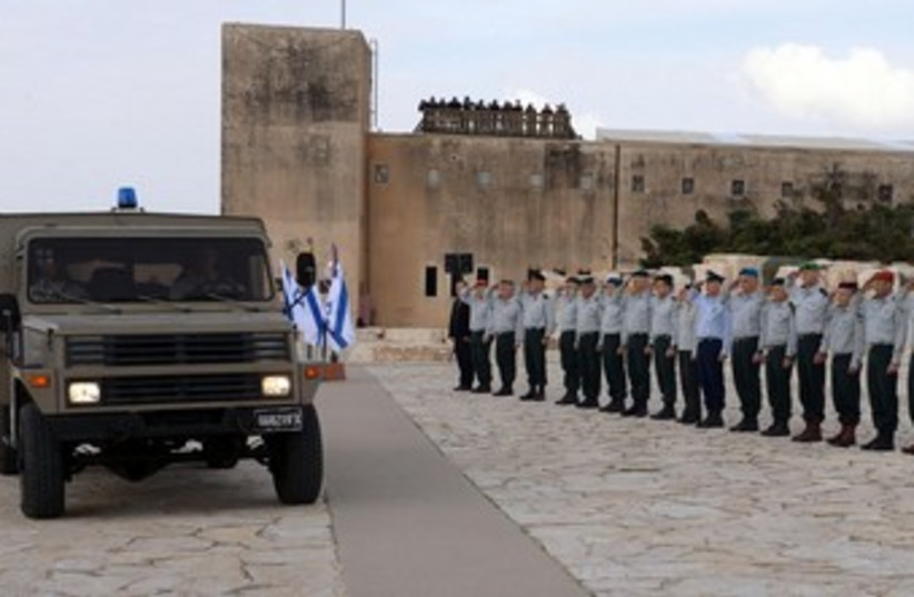 Ariel Sharon's coffin makes a stop at Yad Lashiryon, the Armored Corps Memorial, on its way to his final resting place, January 13, 2014. (photo credit: IDF Spokesman)