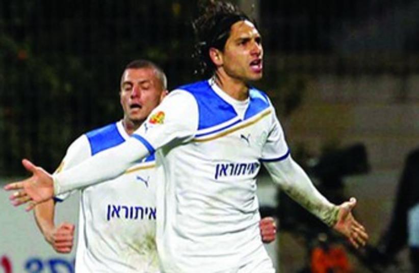Barak Badash scored twice in Ironi Kiryat Shmona's 3-1 home win over Maccabi Tel Aviv. (photo credit: Asaf Kliger)