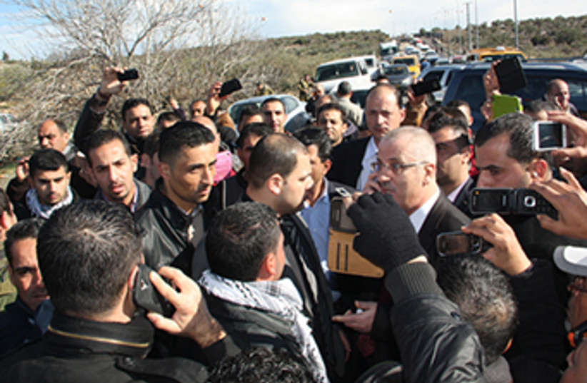 Palestinian Authority Prime Minister Rami Hamdallah after being pulled over by Israel Police in the West Bank on Tuesday.  (photo credit: Farah Studio Ramallah)