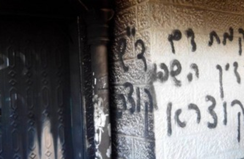 The damage from an attempted arson at a mosque in West Bank (photo credit: Courtesy Rabbis for Human Rights)