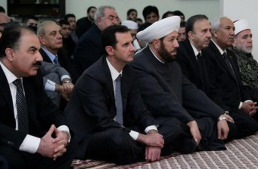 Syrian President Bashar Assad attends prayers marking the birth of the Prophet Muhammed (photo credit: Reuters)