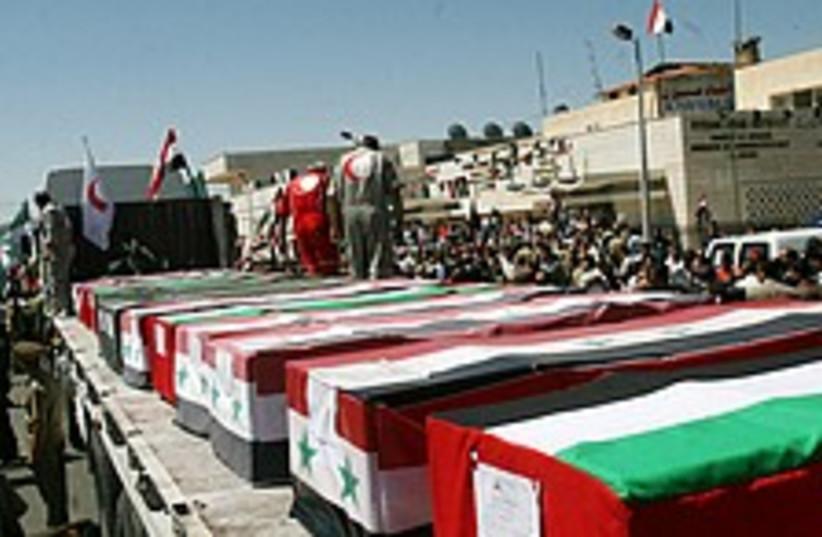 coffins syria 224 88 (photo credit: AP)