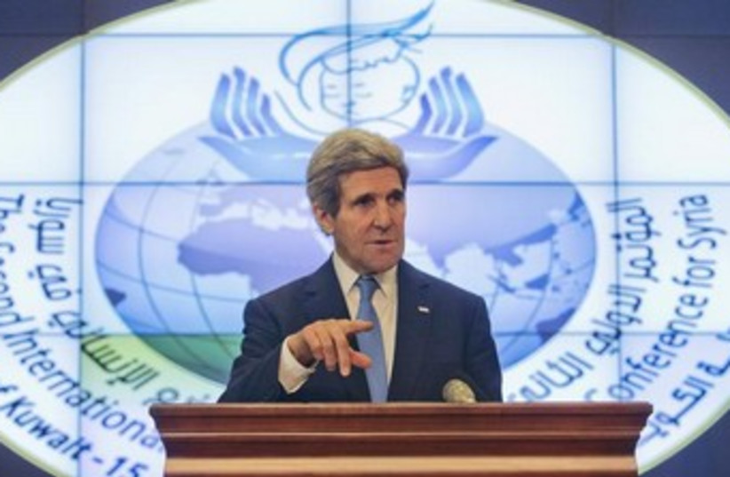 US Secretary of State John Kerry speaks to the press in Kuwait (photo credit: Reuters)