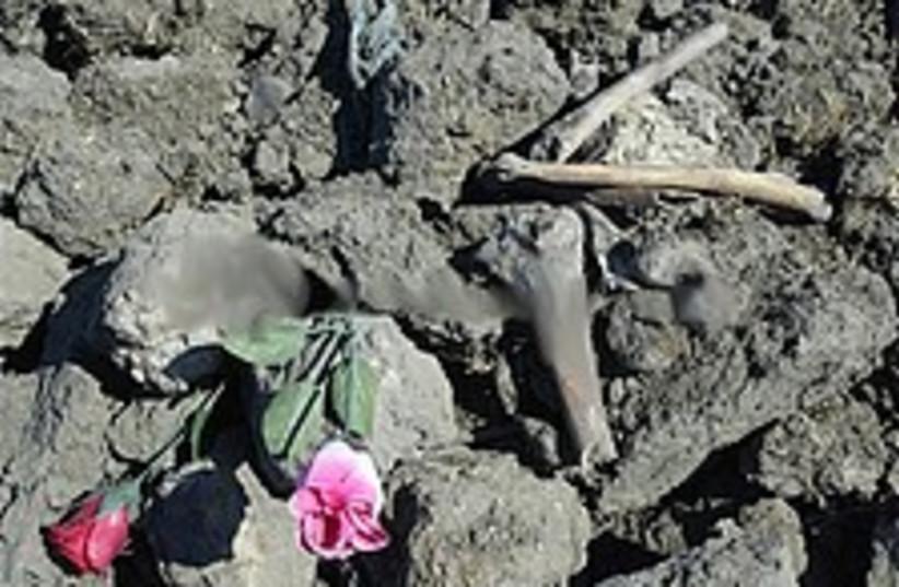flowers mass grave 224 (photo credit: AP)