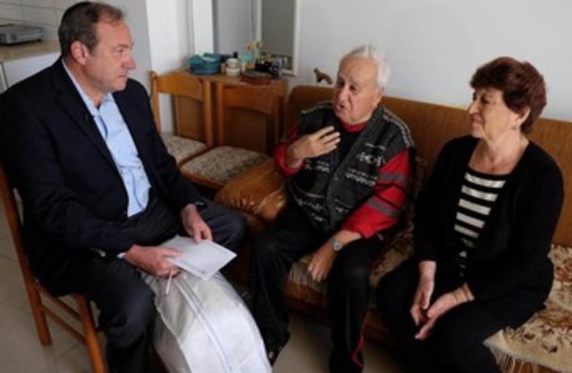 IFCJ Founder and President Rabbi Yechiel Eckstein and Mayor of Ashdod Dr. Yehiel Lasri visit the elderly in Ashdod. (photo credit: Oren Nahshon)