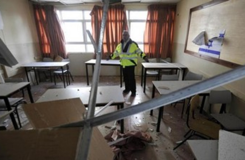 Damage in a classroom from a rocket in Ashkelon, February 28, 2009. (photo credit: REUTERS)