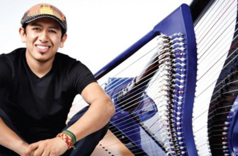 Castañeda and his harp (photo credit: Courtesy)