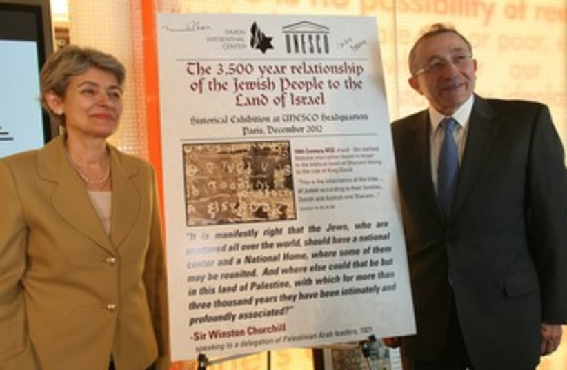 UNESCO director-general Irina Bokova with Simon Wiesenthal Center Dean Rabbi Marvin Hier, next to a panel announcing the exhibit in 2012. (photo credit: Courtesy)