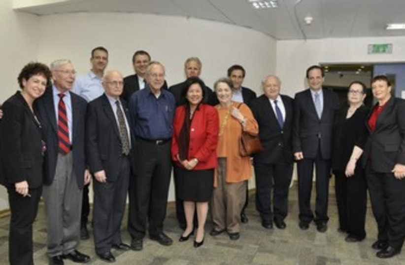 IRENE HIRANO INOUYE (foreground, fifth from left) is surrounded by former Israeli ambassadors to the US and others at the dedication of a scholarship fund in memory of her late husband, US Senator Daniel Inouye (photo credit: ARIEL EILON)