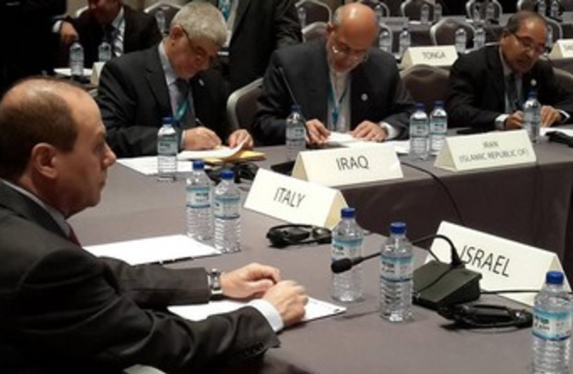 Energy Minister Silvan Shalom at the IRENA assembly with Iranian Energy Minister Hamid Chitchiyan  in Abu Dhabi. (photo credit: Courtesy)