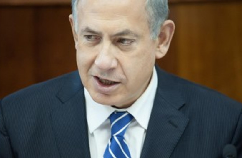 Prime Minister Binyamin Netanyahu at the weekly cabinet meeting, January 19, 2014. (photo credit: EMIL SALMAN/POOL)