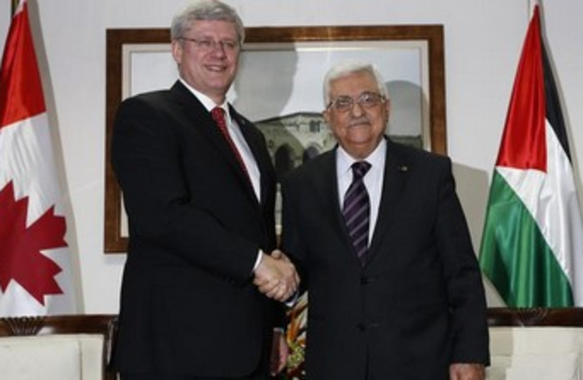 Canadian Prime Minister Stephen Harper and Palestinian Authority President Mahmoud Abbas in Ramallah on Monday. (photo credit: REUTERS)
