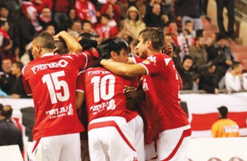 Hapoel Beersheba players had every reason to celebrate last night after they beat Maccabi Haifa 3-1 at Vasermil Stadium. (photo credit: MEIR EVEN HAIM)