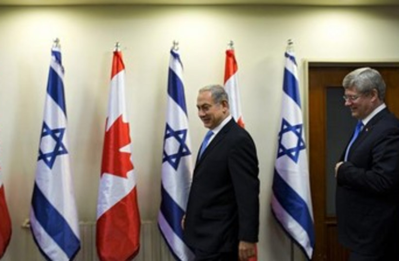 Prime Minister Binyamin Netanyahu and Canada's Prime Minister Stephen Harper in Jerusalem, January 21, 2014. (photo credit: REUTERS)
