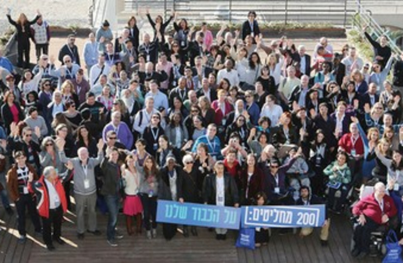 'Assembly of 200' conference participants gather for a picture in Jerusalem for IDI's Israel Speaks: Human Dignity initiative. (photo credit: ISRAEL DEMOCRACY INSTITUTE)