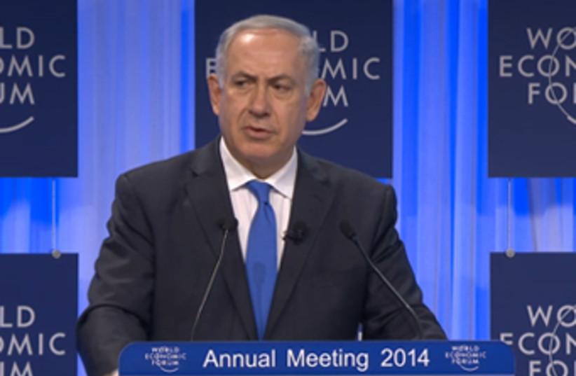 PM Netanyahu speaks at Davos Economic Forum (photo credit: SCREENSHOT DAVOS WORLD ECONOMIC FORUM)