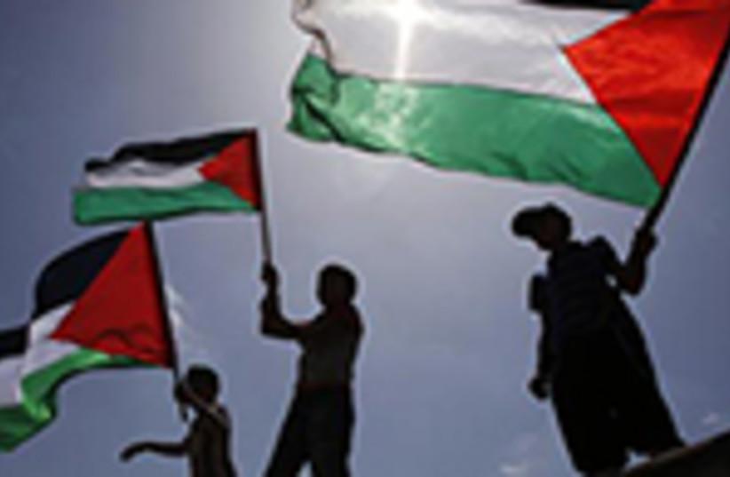 Palestinians wave PLO flags (photo credit: REUTERS)