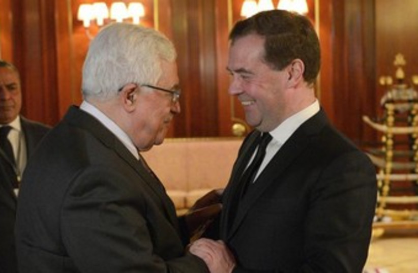 Russia's Prime Minister Dmitry Medvedev (R) meets with Palestinian President Mahmoud Abbas at the Gorki residence outside Moscow January 23, 2014.  (photo credit: REUTERS)