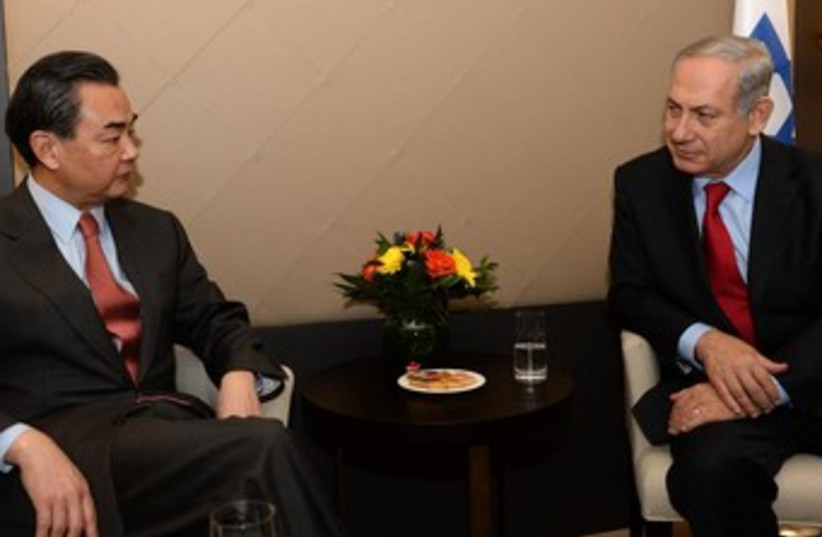 Netanyahu meets with Chinese FM Wang Yi in Davos  (photo credit: GPO)