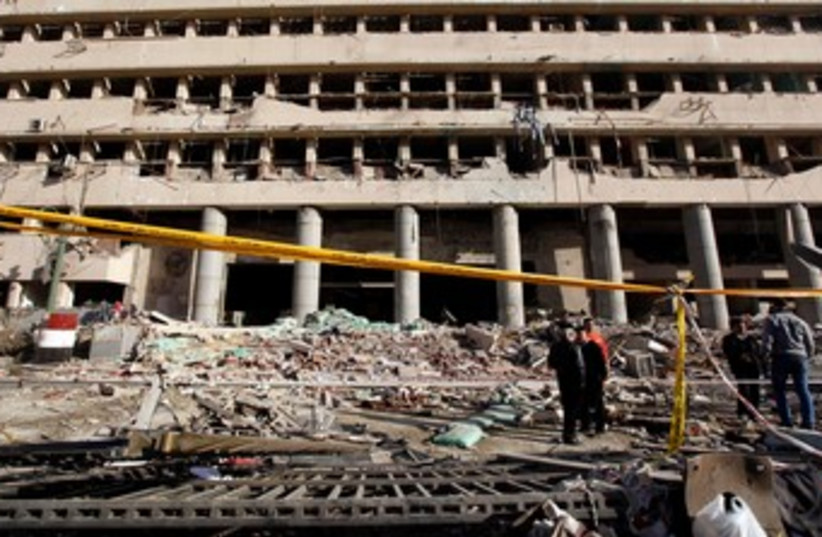 Cairo bombing destroyed building Jan 24 2014 (photo credit: REUTERS)