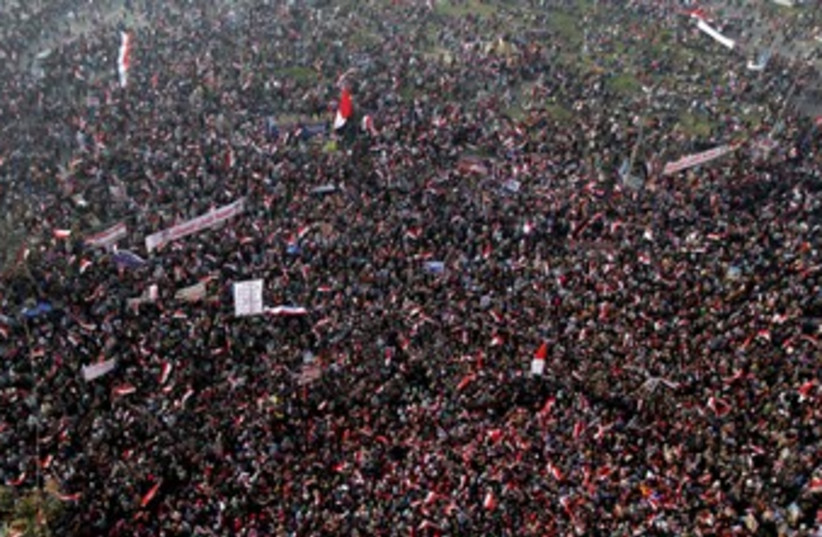 Protest in Tahrir, Cairo, Jan. 25 2014 (photo credit: REUTERS)