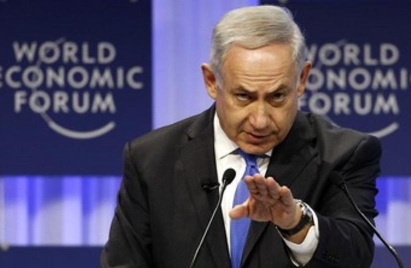 Prime Minister Binyamin Netanyahu speaking at the World Economic Forum in Davos, January 23, 2014. (photo credit: REUTERS)