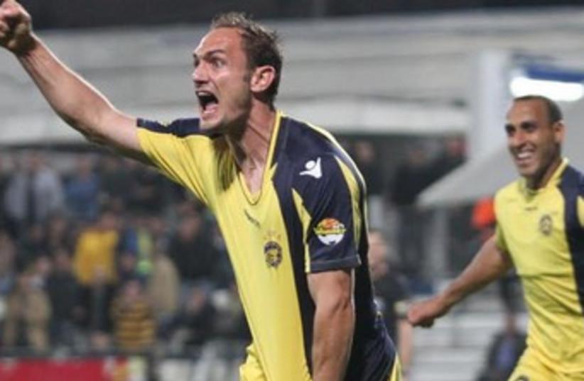 Maccabi Tel Aviv defender Carlos Garcia celebrates after scoring his first goal for the club during his team's 3-0 victory at Hapoel Ramat Hasharon. (photo credit: ADI AVISHAI)