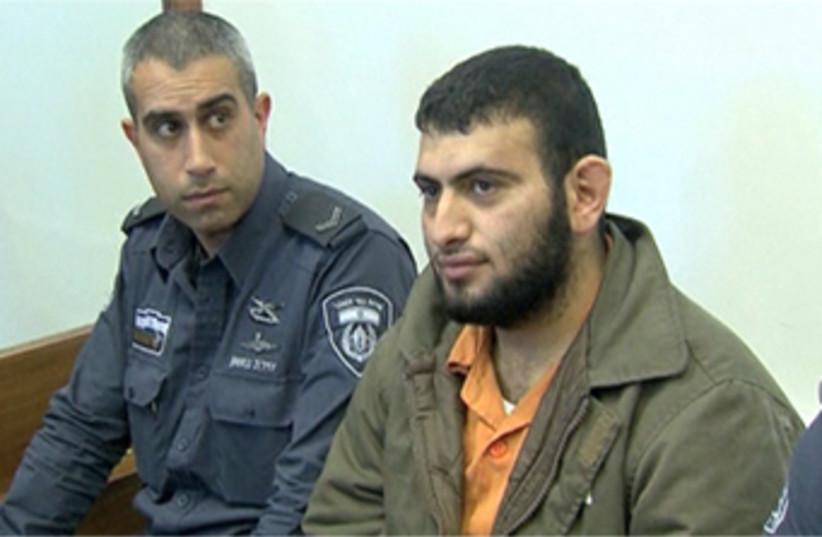 Suspected al-Qaida cell member Khalil Abu Sara enters Ashkelon court room (photo credit: REUTERS)