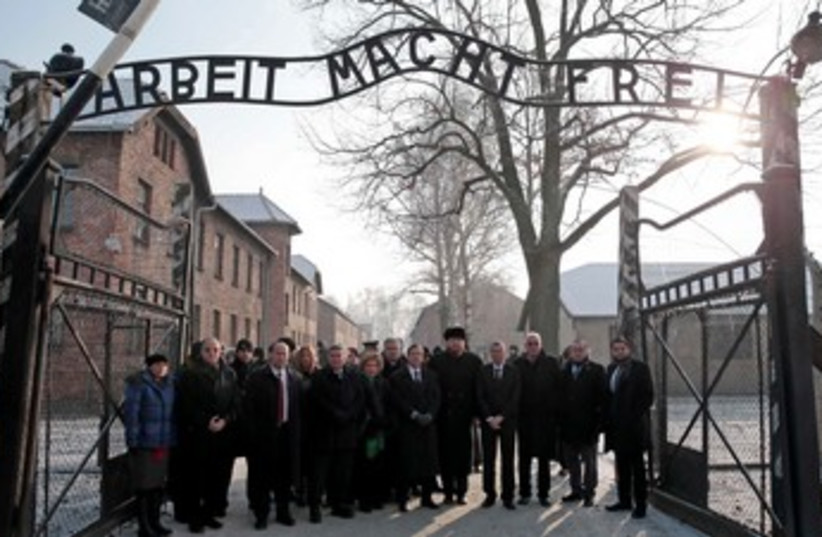 Members of the Knesset pose at the entrance of Auschwitz concentration camp (photo credit: REUTERS)