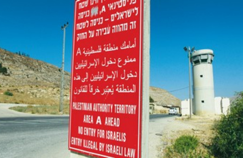 A sign in the West Bank banning Israeli entry to a Palestinian controlled area. (photo credit: REUTERS)