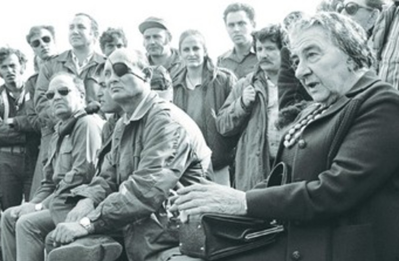 Then-prime minister Golda Meir with IDF soldiers and defense officials after the end of the Yom Kippur War in 1973. (photo credit: REUTERS)