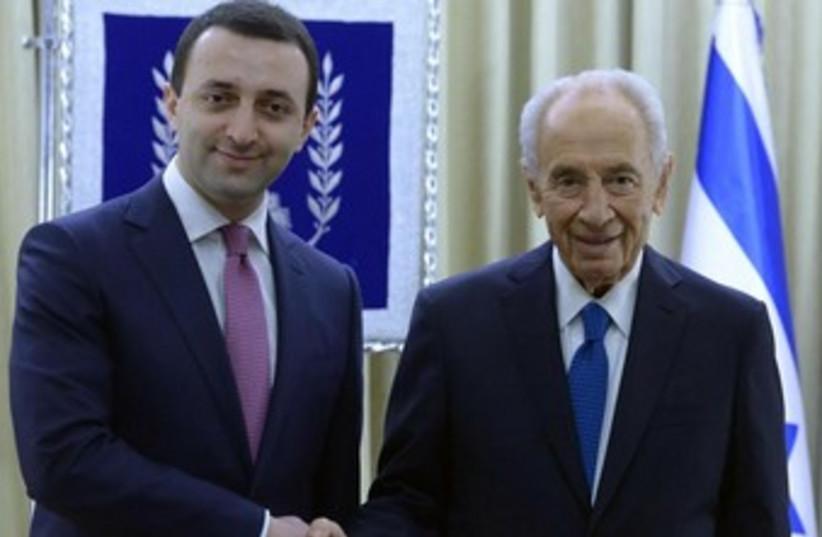 President Shimon Peres meets with Georgian Prime Minister Irakli Garibashvili. (photo credit: Mark Neiman/GPO)