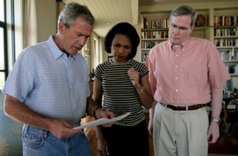Former US president George W. Bush meets with his Secretary of State Condoleezza Rice and his National Security Advisor Stephen Hadley at the Bush Ranch to discuss the Middle East. (photo credit: Wikimedia Commons)