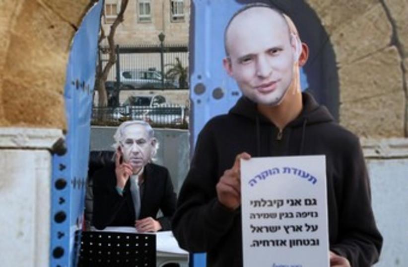 A Bennett vs. Netanyahu masks demostration. (photo credit: MARC ISRAEL SELLEM/THE JERUSALEM POST)