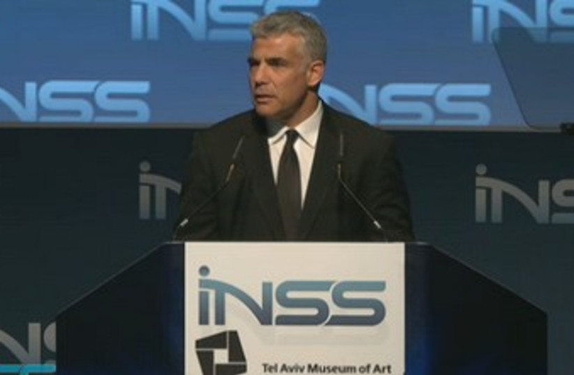 Finance Minister Yair Lapid addresses the INSS conference in Tel Aviv, January 29, 2014. (photo credit: INSS)