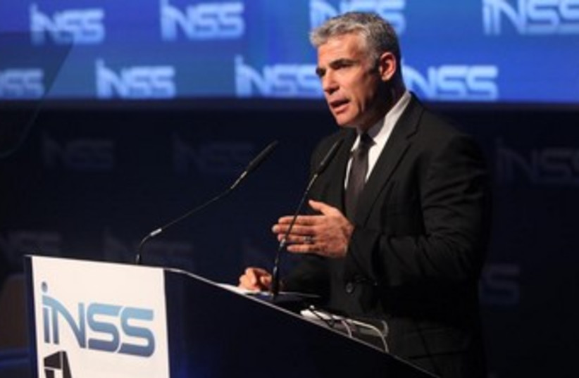 Finance Minister Yair Lapid addresses the INSS conference in Tel Aviv, January 29, 2014. (photo credit: CHEN GALILI)
