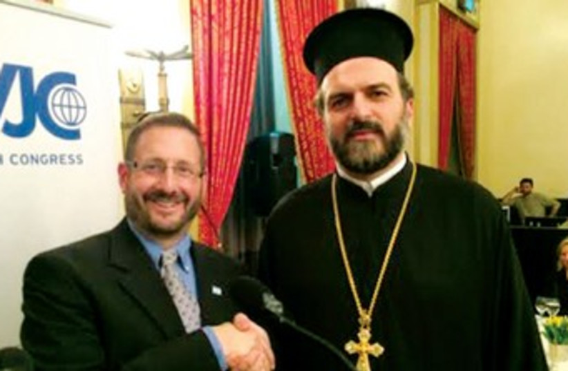 Fr. Gabriel Naddaf with MK Dov Lipman. (photo credit: SAM SOKOL)