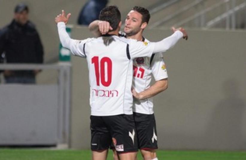 Hapoel Haifa teammates Maharan Lala (10) and Yuval Avidor. (photo credit: ASAF KLIGER)