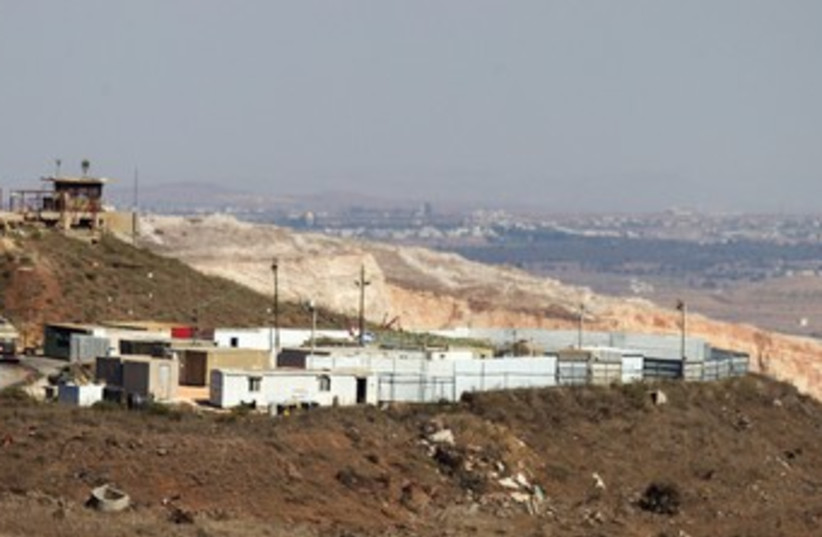 WOUNDED SYRIANS are treated at this Israeli field hospital on the Golan Heights. (photo credit: REUTERS)